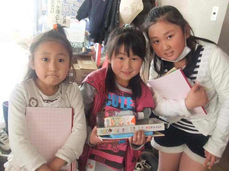 Children with some books and games that were donated