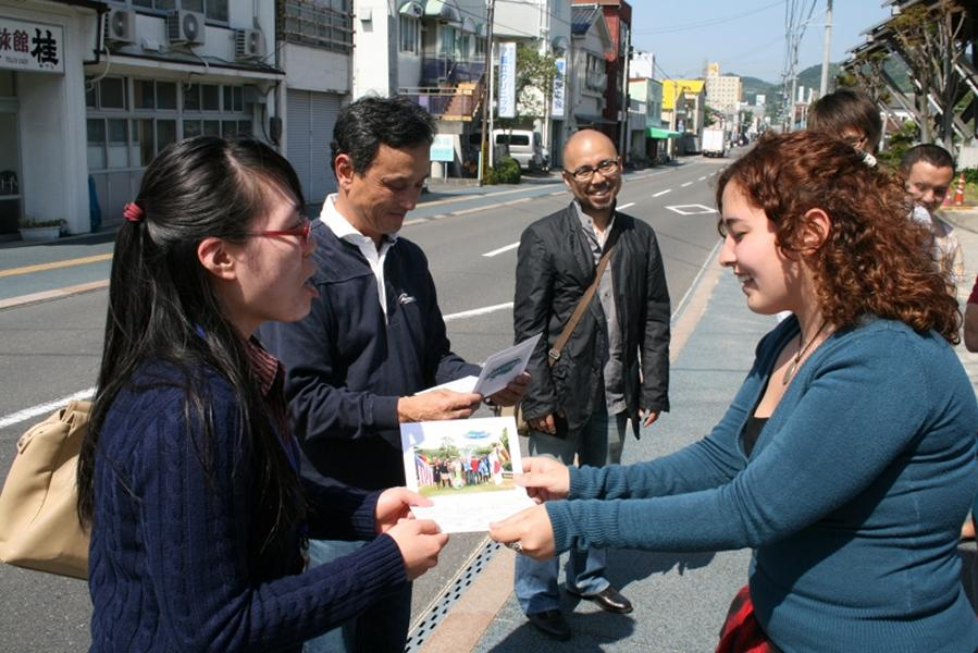 thanking tour guide and translator