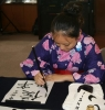 Zuxin doing calligraphy