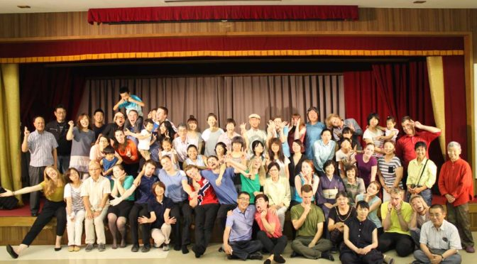 Group photo with host families in Uda