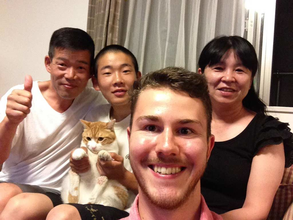 Thomas and his host family in Omura