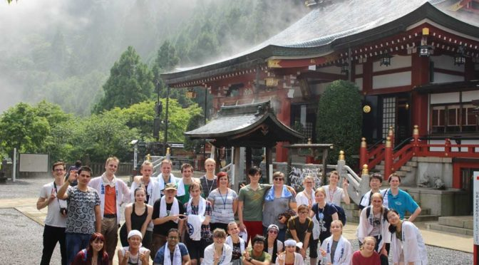 Group picture by Oyama shrine with water evaporating from the shrine roof