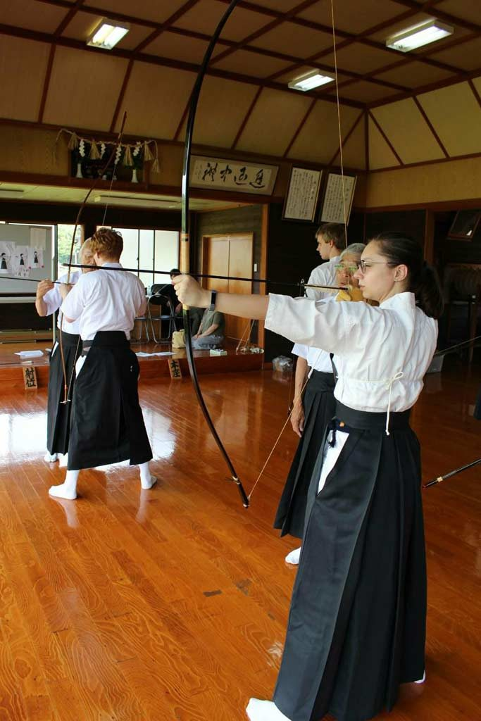 Helena about to shoot a Japanese yumi bow in Omura
