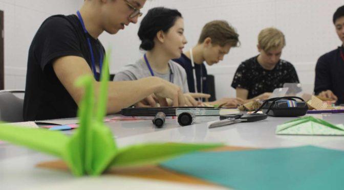 World Campus Japan members folding origami