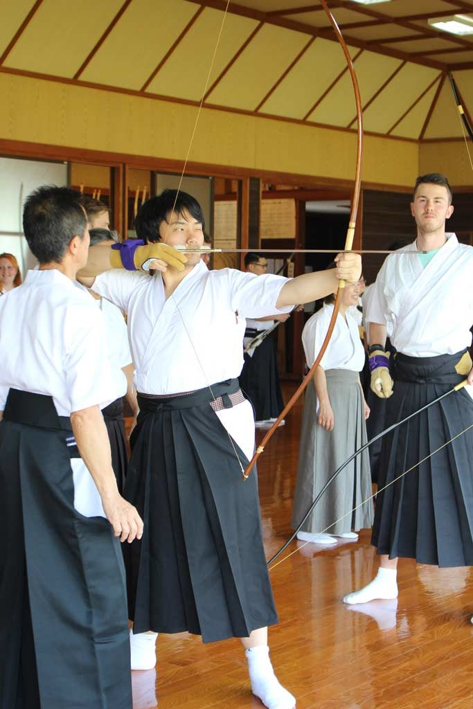 Henry shooting with Kyudo bow in Omura