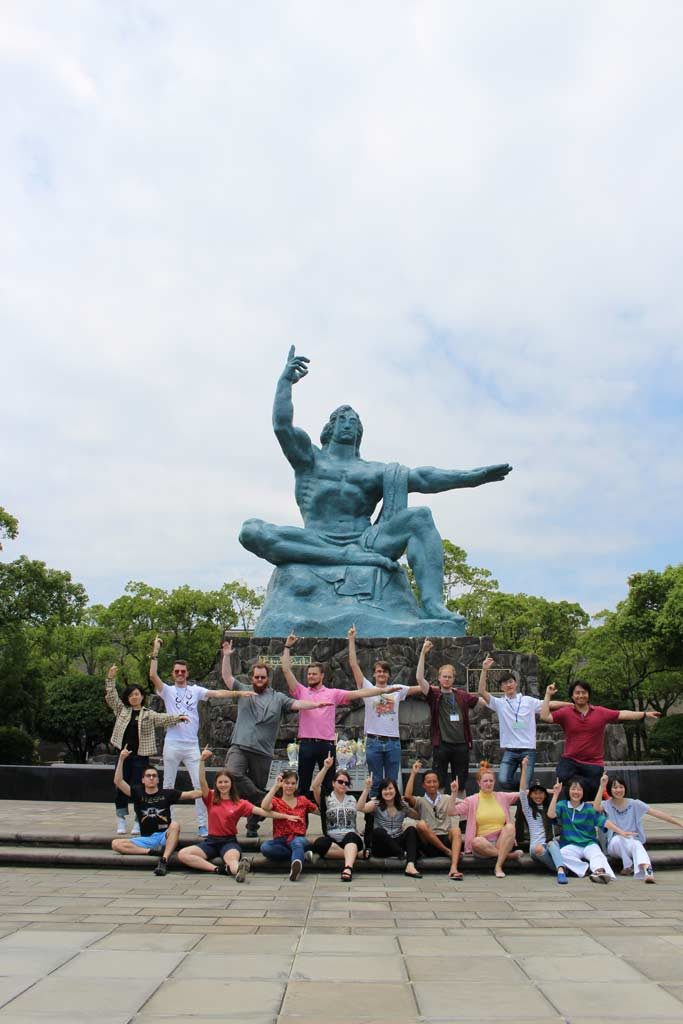 Posing in front of the peace statue