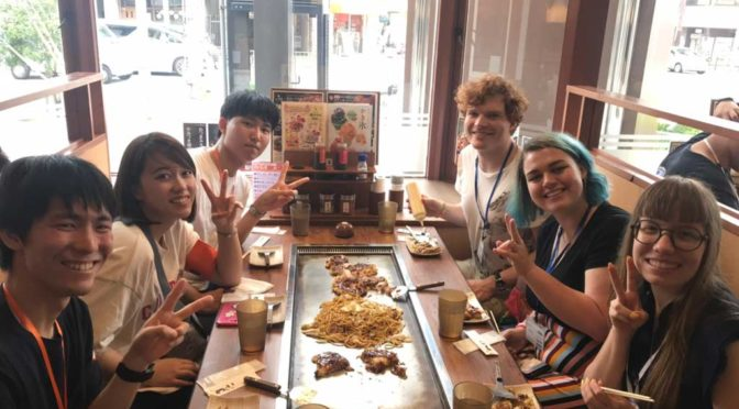 My group enjoying the specialities of Osaka